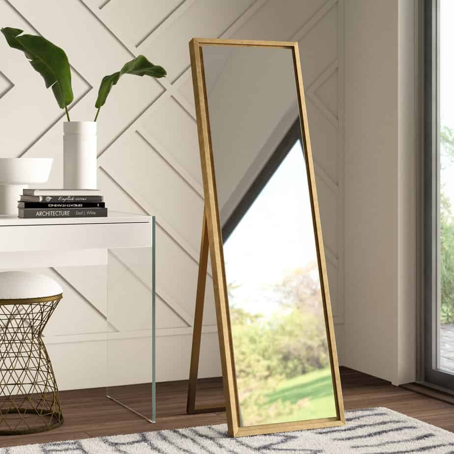 popular home decor trends 2021 full height standing mirror and a plant